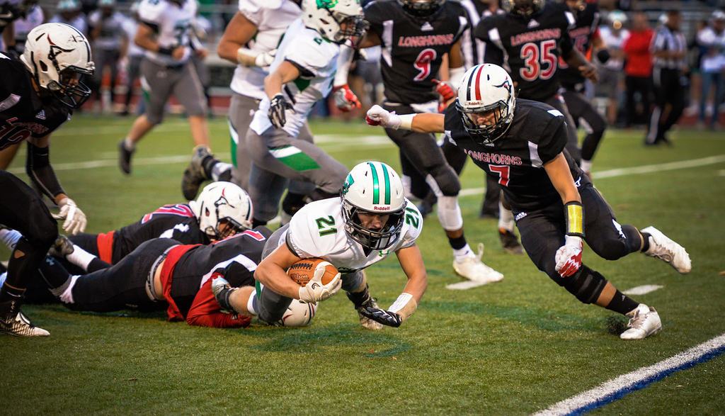 . Aimee Bielozer - The Morning Journal<br> Columbia\'s Ben Alten is brought down after a dive for extra yards by the Lutheran West defense on Sept. 29.