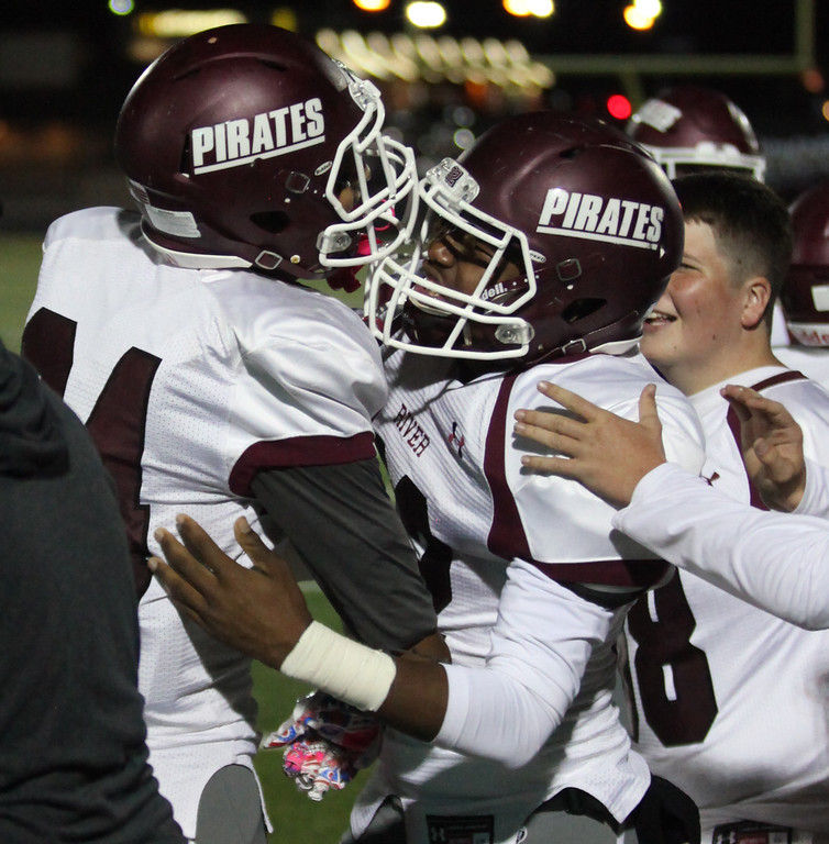 . Randy Meyers - The Morning Journal<br> Rocky River\'s Christain Dean is congratulated by teammates after a touchdown in the second quarter against Normandy on Oct. 12.