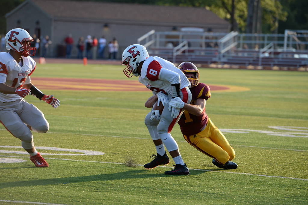 . Aimee Bielzozer - The Morning Journal<br> Elyria\'s Dayonte Horton is brough down from behind by Avon Lake\'s Caleb Burr on Aug. 25.