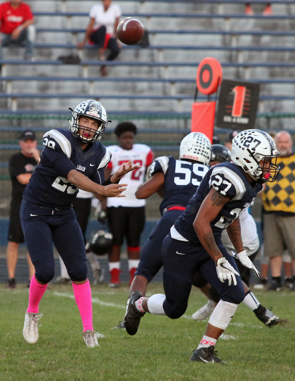 . Randy Meyers - The Morning Journal<br> Lorain quarterback Justin Sturgill throws a swing pass to a receiver against Clarkson during the first quarter on Sept. 22.