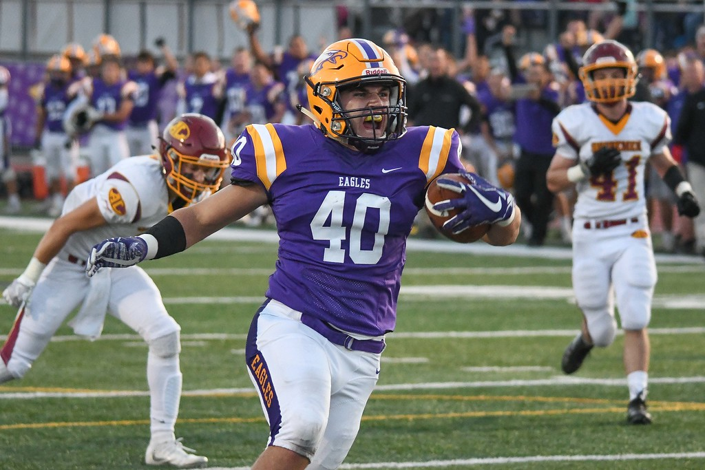 . Eric Bonzar�The Morning Journal<br> Avon\'s Kyle Kudla (40) rushes his way in to the end zone, uncontested, for 6 points, Sept. 8, 2017.