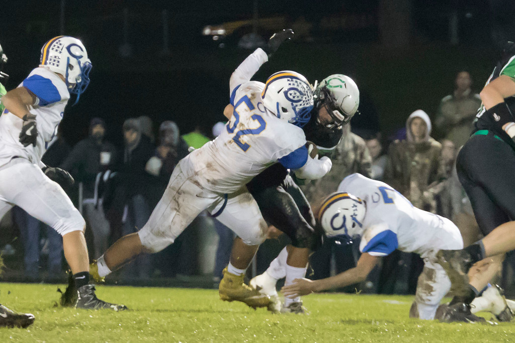 . Jen Forbus - The Morning Journal<br> Clearview defensive lineman Collin Manning (52) and defensive back Fabion Kirkwood team up to bring down Clear Fork\'s ball carrier on Nov. 3.