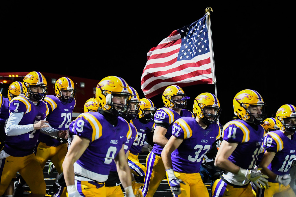 . Eric Bonzar�The Morning Journal<br> The Avon Eagles take the field for their D-II Regional Final Championship match-up against the Olmsted Falls Bulldogs, 55-14, Nov. 17, 2017.