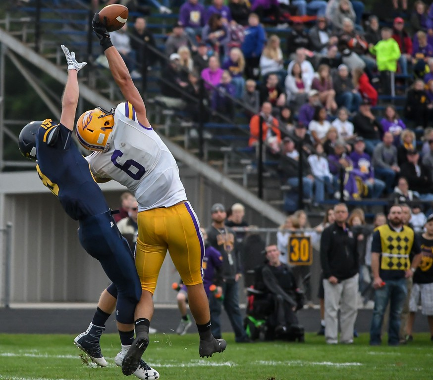 """. Eric Bonzar - The Morning Journal<br> Avon\'s Vlasi Pappas makes a one-handed grab as he tumbles into the end zone for a touchdown. The catch was features on ESPN\'s \""""SportsCenter\"""" and was named the No. 1 play in the daily Top-10."""