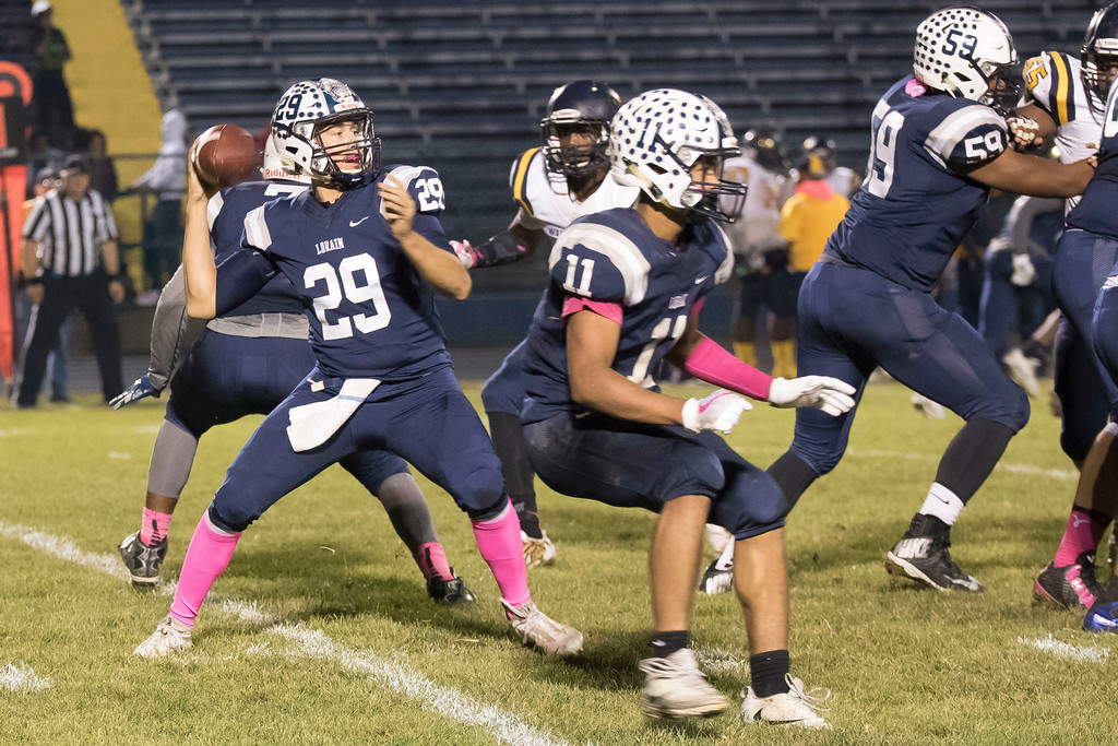 . Jen Forbus - The Morning Journal<br> Lorain quarterback Justin Sturgill takes aim for a pass against Warrensville Heights on Oct. 6.