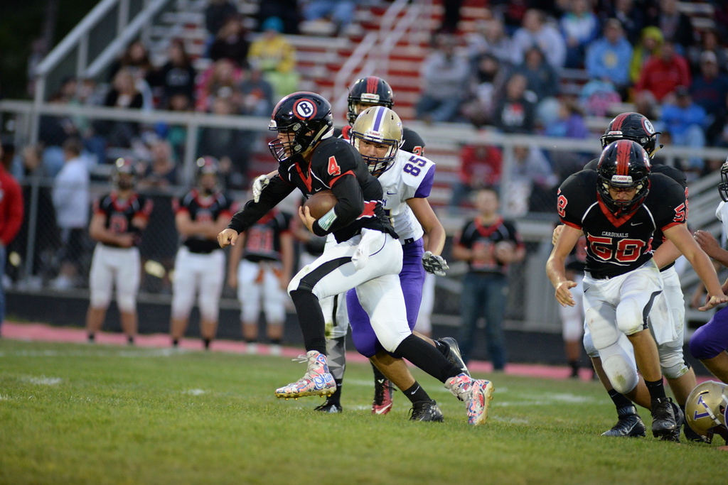 . Aimee Bielozer - The Morning Journal<br> Brookside quarterback Jonathan Hice scrambles under pressure from Vermilion\'s Like Pena on Sept. 1.