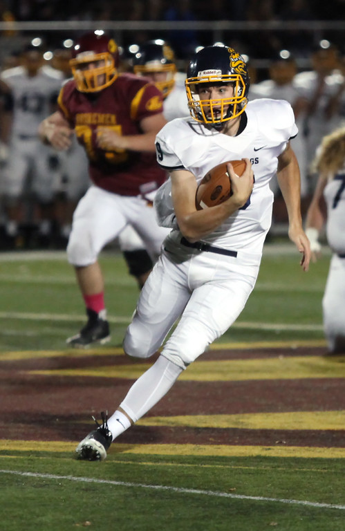 . Randy Meyers - The Morning Journal<br> Olmsted Falls quarterback Teddy Grendzynski runs through the Avon Lake defense near midfield for a big gain during the first quarter on Oct. 20.