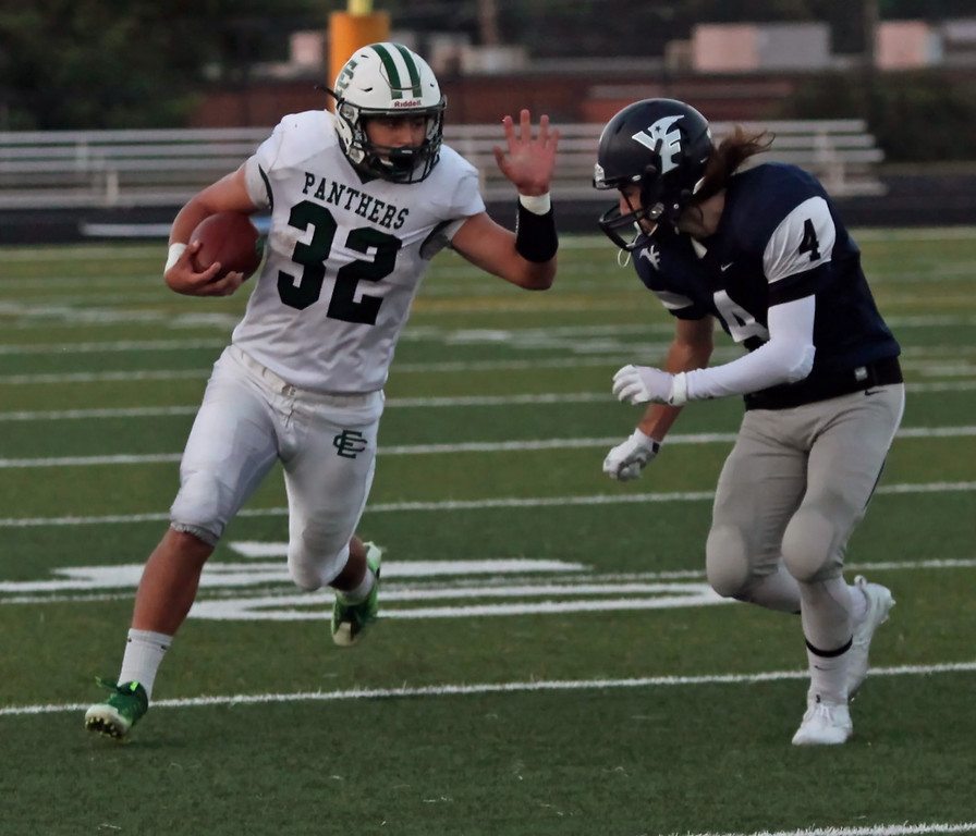 . Randy Meyers - The Morning Journal<br> Leighton Banjoff of Elyria Catholic tries to avoid the tackle by Dylan Magda of Valley Forge as he picks up yardage during the first quarter on Sept. 21.