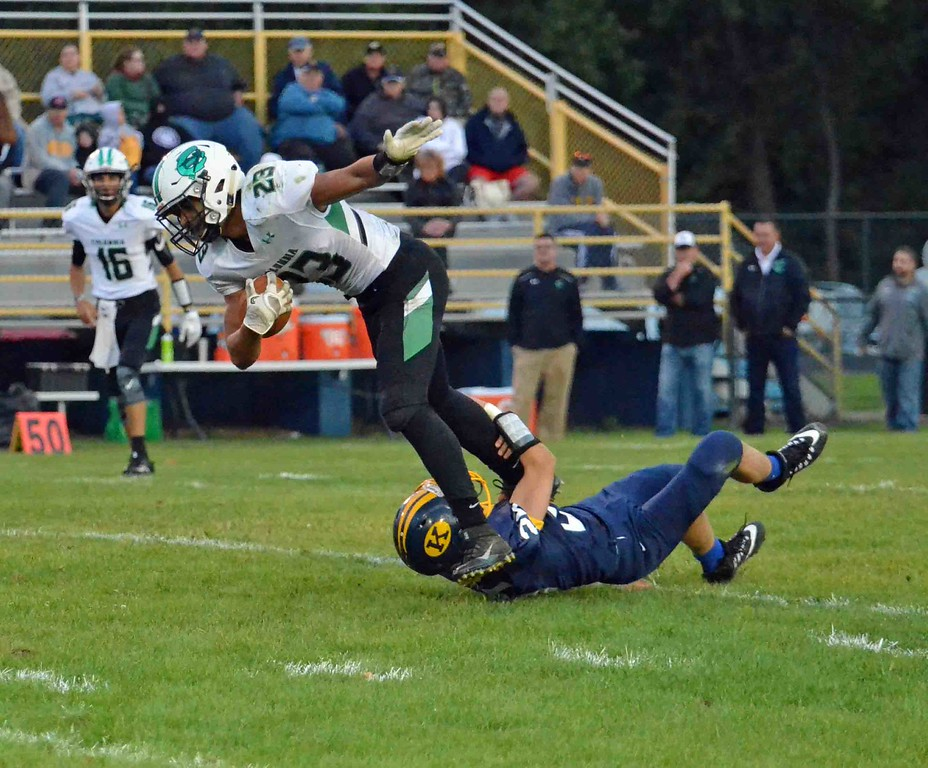 . Paul DiCicco - The News-Herald<br> Columbia\'s Brandon Coleman is barely tackled by a Kirtland defender on Sept. 1.