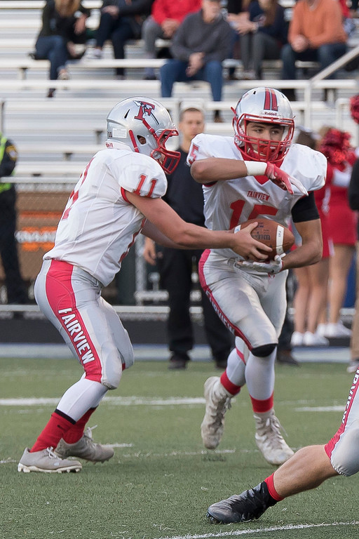 . Jen Forbus - The Morning Journal<br> Fairview running back Jack Provenza takes the handoff from quarterback Tommy McNamara in their first possession of the game against Bay on Sept. 8.