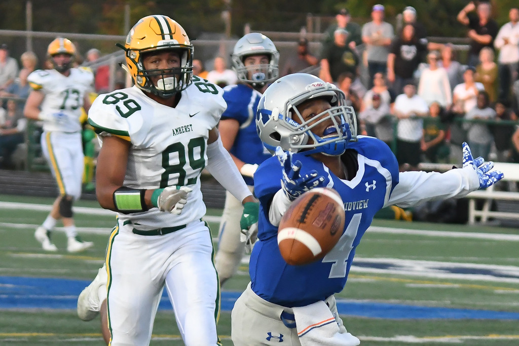 . Eric Bonzar�The Morning Journal<br> Midview\'s Isiah Johnson (4) is overthrown on a  pass from quarterback Seamus Higley, Sept. 15, 2017.