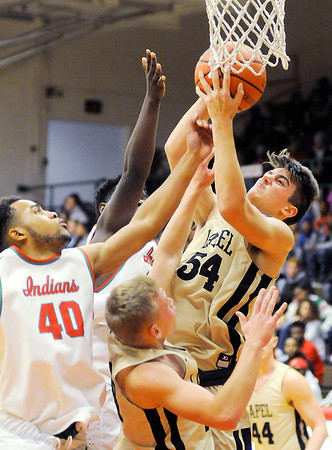 Don Knight   The Herald Bulletin<br /> Lapel's Gage White pulls down a rebound as the Anderson Indians hosted the Bulldogs on Friday.