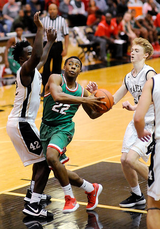 Don Knight |  The Herald Bulletin<br /> Anderson's Keyounis Woods drives into the lane against Lapel's Preston Scott as the Bulldogs hosted the Indians on Friday.