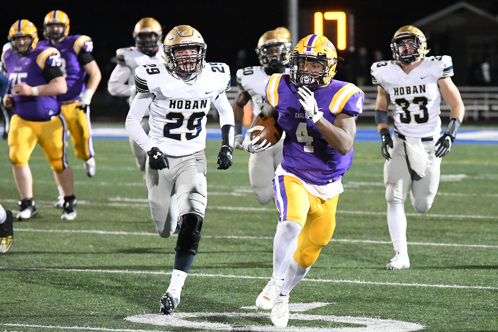 . Eric Bonzar�The Morning Journal<br> Avon running back Tony Eberhardt (4) breaks through to the second level of the Akron Archbishop Hoban defense.