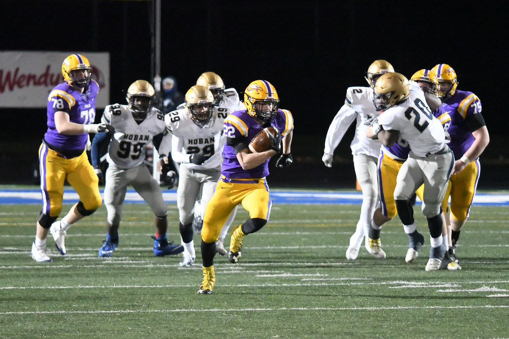 . Eric Bonzar�The Morning Journal<br> Avon running back Nick Perusek (22) finds a hole in the Akron Archbishop Hoban defense.