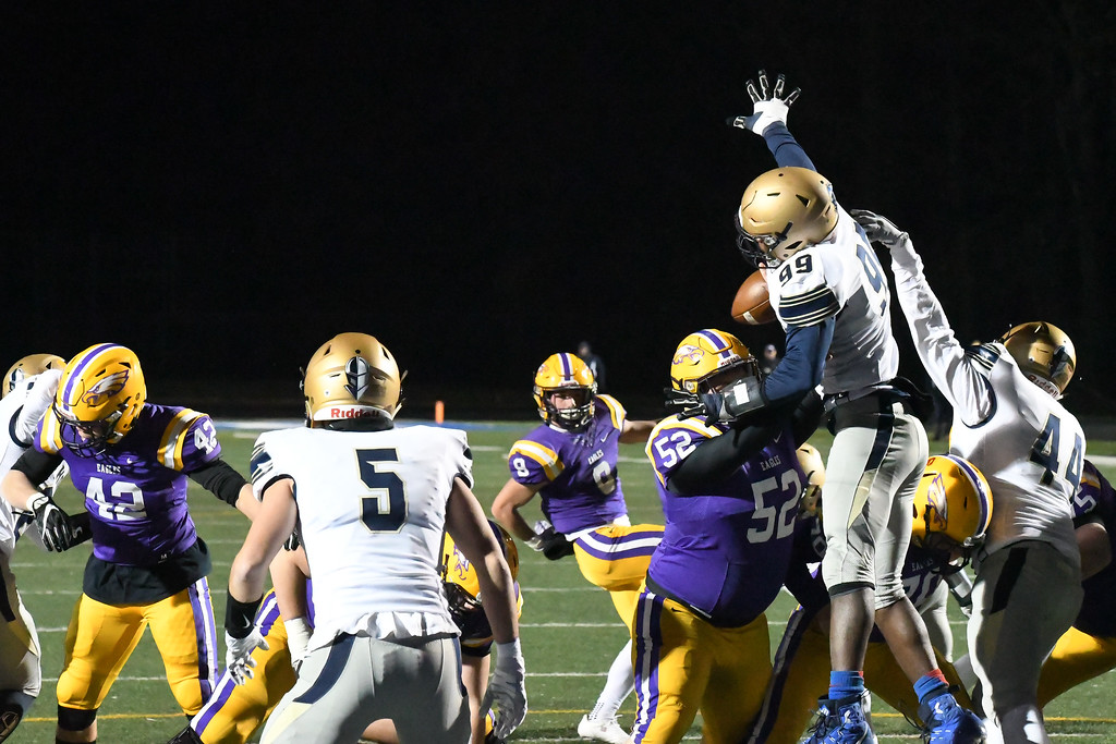 . Eric Bonzar�The Morning Journal<br> Akron Archbishop Hoban Knights\' Da\'Viaun Pete (99) blocks an extra point by Avon kicker David Orlando (9).