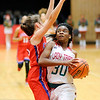 Don Knight | The Herald Bulletin<br /> Anderson's Tyra Ford draws a foul from Kokomo's Chloe McClain on a drive to the basket as the Indians hosted Kokomo on Saturday.