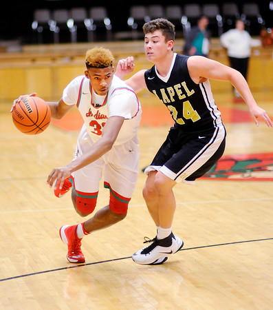 Don Knight | The Herald Bulletin<br /> Anderson's Marquavius Beverly drives as he is guarded by Lapel's Will Jones at the Teepee on Friday.