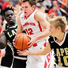 Don Knight |  The Herald Bulletin<br /> Frankton's Landon Weins pulls down an offensive rebound between Lapel's Preston Scott and Carson Huber as the Eagles hosted the Bulldogs on Saturday.