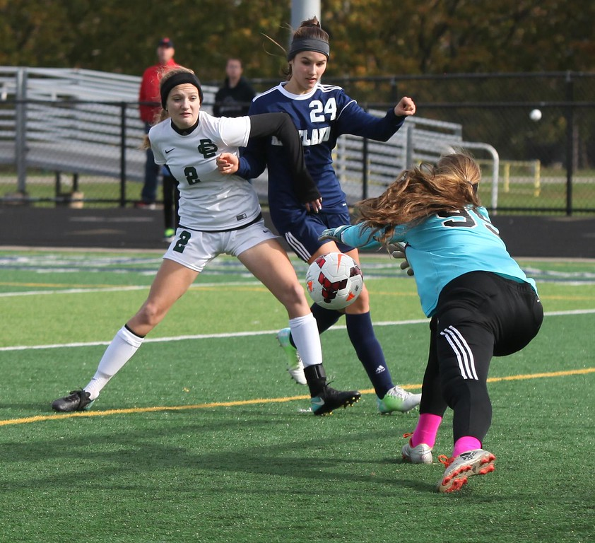 . Randy Meyers - The Morning Journal<br> Elyria Catholic goal keeper Megan Scheibelhut saves a shot on gaol by Jenna Sayle of Kirtland during the first half on Nov. 4.