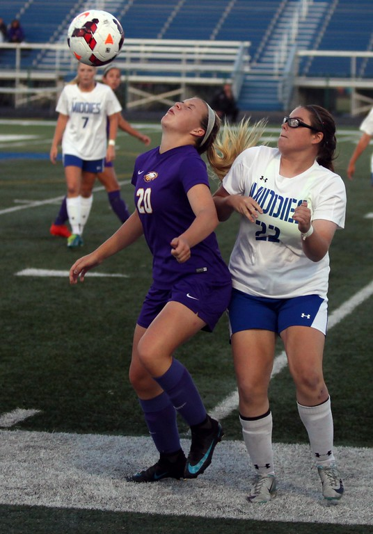 . Randy Meyers - The Morning Journal<br> Avon\'s Anna Brethauer takes a ball off of her face in front of Erin Simpson of Midview on Sept. 6.