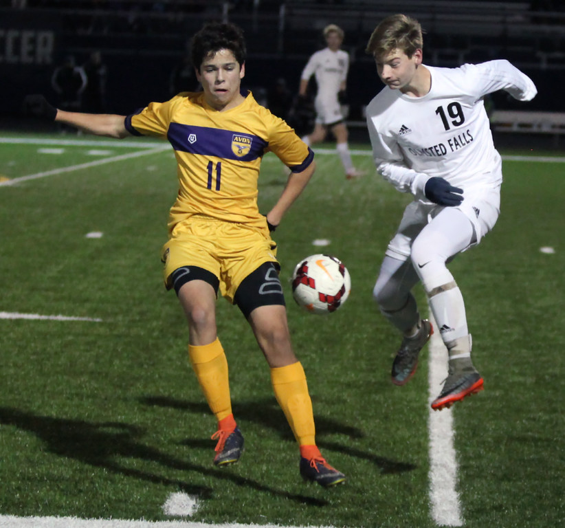 . Randy Meyers - The Morning Journal<br> The ball bounces in between William Wendling of Avon and Alex Klek of Olmsted Falls near the sideline during the first half of the Division I Elyria District final on Oct. 28 at North Ridgeville.