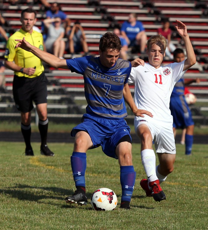 . Randy Meyers - The Morning Journal<br> Midview\'s Kiel Wells blocks Joshua Rader from the ball during the first half on Aug. 19.