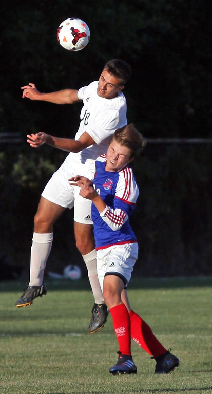 . Randy Meyers - The Morning Journal<br> Westlake\'s Ali Al Khatib heads the ball to a teammate in front of Nolan Sooy of Bay during the first half on Aug. 18.