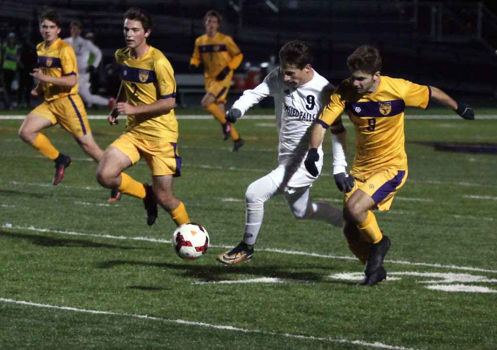 . Randy Meyers - The Morning Journal<br> Ryan Kolonick of Olmsted Falls moves the ball past the Avon defense in the open field during the first half of the Division I Elyria District final on Oct. 28 at North Ridgeville.