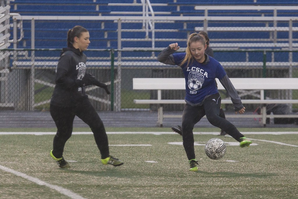 . Jen Forbus - The Morning Journal<br> Columbia\'s Lanie Welker (Blue) shows her ball handling skills as Wellington\'s Victoria Horoschak (Grey) moves in to try and stop her during the Lorain County Senior All-Star Game on Nov. 18.