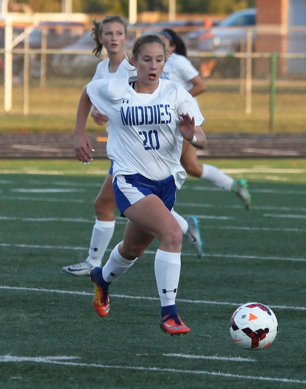. Randy Meyers - The Morning Journal<br> Midview\'s Ashley Dekam pushes the ball ahead of the Avon defense near midfield during the first half on Sept. 6.