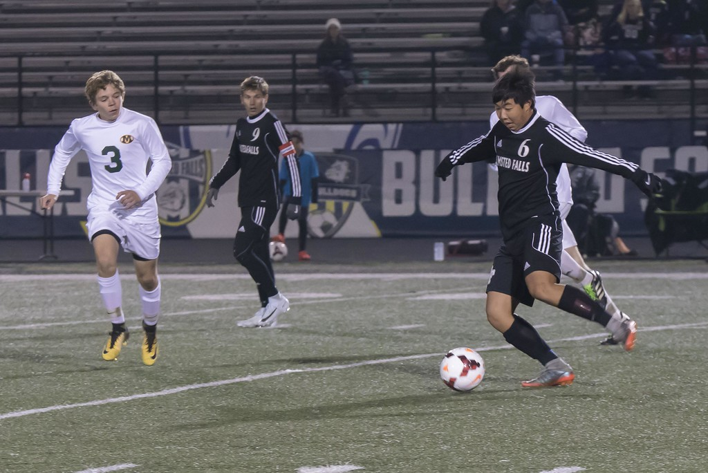 . Jen Forbus - The Morning Journal<br> Olmsted Falls midfielder Noah Le (6) controls the ball as Medina\'s Gavin Csiszar (3) closes in on Nov. 1.