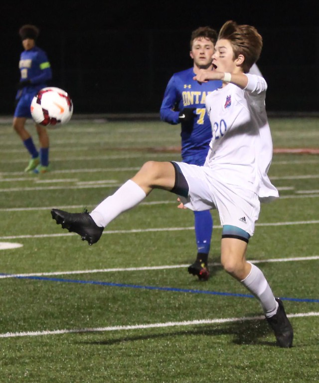 . Randy Meyers - The Morning Journal<br> Bay\'s Nolan Sooy stops the ball near the sideline and in front of Ontario\'s Andrew Male during the first half on Nov. 1.