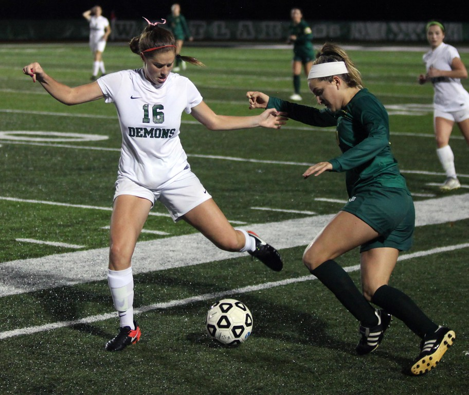 . Randy Meyers - The Morning Journal<br> Westlake\'s Madyson Maynard kicks the ball away from Helena Medve of Amherst near the sideline during the first half of tournament play on Oct. 23.