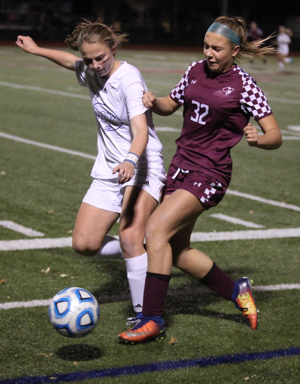 . Randy Meyers - The Morning Journal<br> Bay\'s Caroline Fowles battles Maya Patti of Rocky River for the ball near the sideline during the first half of the Division II Elyria District final on Oct. 26 at Lutheran West.