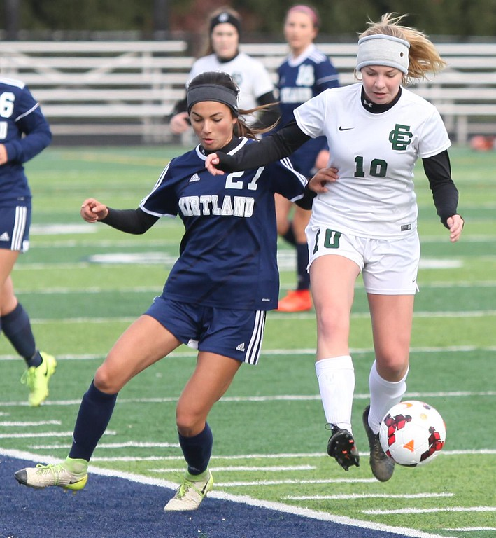 . Randy Meyers - The Morning Journal<br> Sadie Hutsenpillar of Elyria Catholic kicks past Maya Zovko of Kirtland during the first half on Nov. 4.