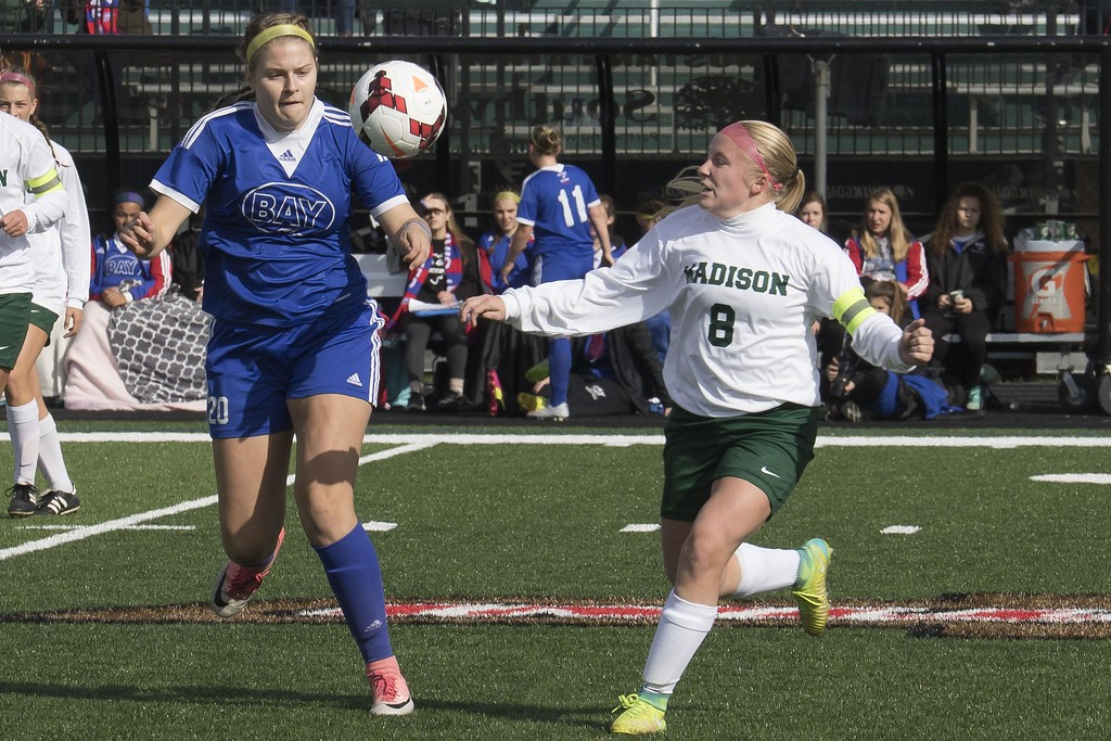 . Jen Forbus - The Morning Journal<br> Bay midfielder Abby Shuster and Madison midfielder Tara Andrews (8) race for the ball on Nov. 4.