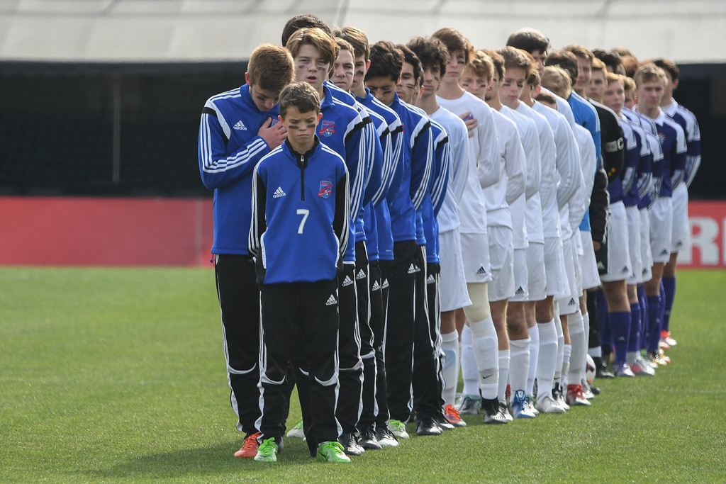. Eric Bonzar�The Morning Journal<br> The Bay Rockets and Columbus St. Francis DeSales soccer teams stand for the National Anthem before the start of the D-II State Soccer Championship game, Nov. 11, 2017.