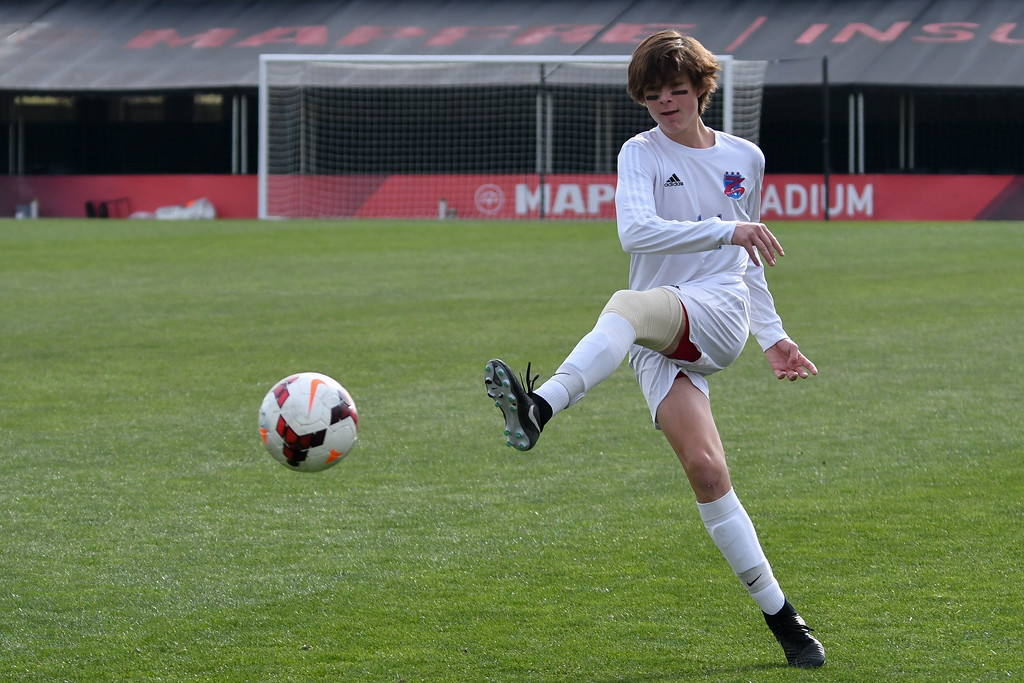 . Eric Bonzar�The Morning Journal<br> Bay forward Cade Gergye (14) warms up before the start of the D-II State Soccer Championship game against Columbus St. Francis DeSales, Nov. 11, 2017.