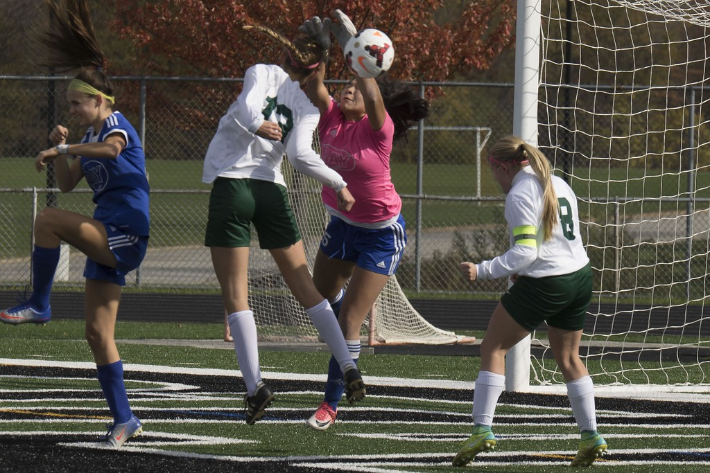 . Jen Forbus - The Morning Journal<br> Bay goal keeper Gigi Merk deflects a header from Madison midfielder Taylor Huff on Nov. 4.