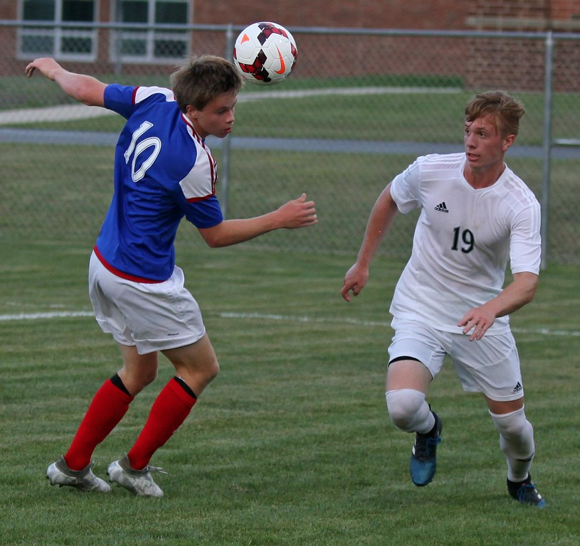 . Randy Meyers - The Morning Journal<br> Bay\'s Kyle Cusimano heads the ball away from Cory Dubois of Westlake during the first half on Aug. 18.