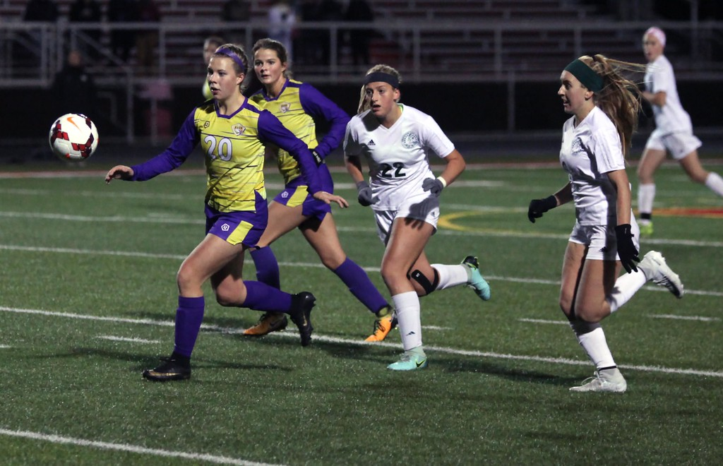. Randy Meyers - The Morning Journal<br> Avon\'s Anna Brethauer chases down the ball in front of Lauren Rakytiak and Vanessa DiNardo of Strongsville during the first half of a regional semifinal on Oct. 31.