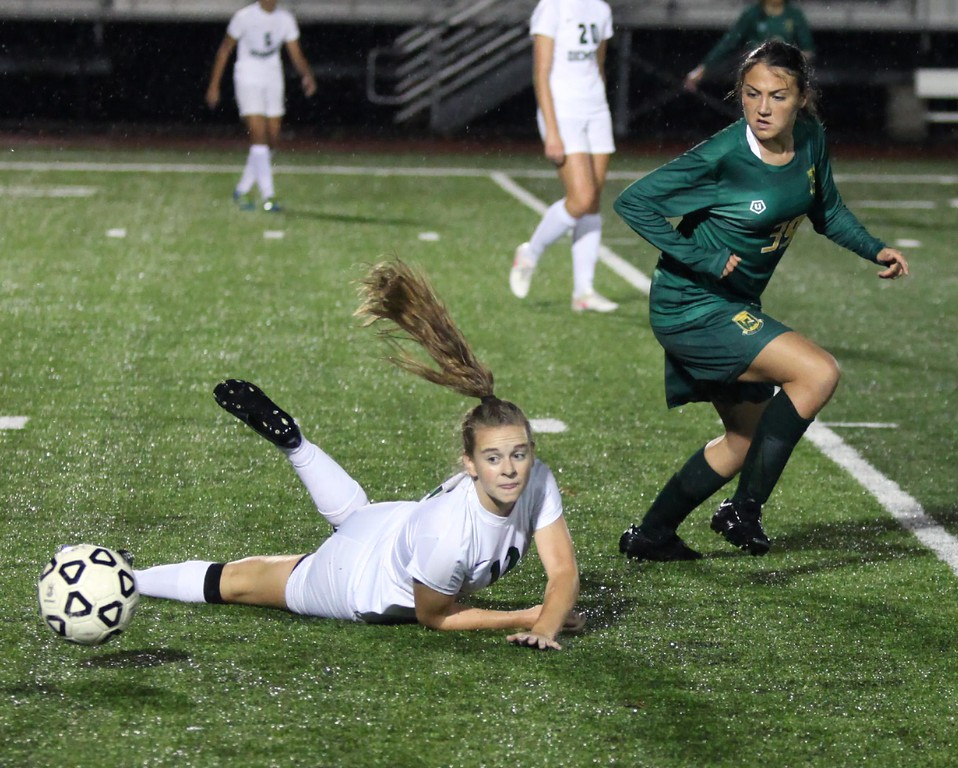 . Randy Meyers - The Morning Journal<br> The ball bounces away from Westlake\'s Meredith Hansen after she collides with Leah Drost of Amherst during a Division I semifinal on Oct. 23.