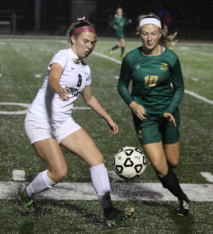 . Randy Meyers - The Morning Journal<br> Kamryn Dziak of Amherst and Samantha Jablonski of Westlake close in on the ball at the sideline during the first half on Oct. 23.