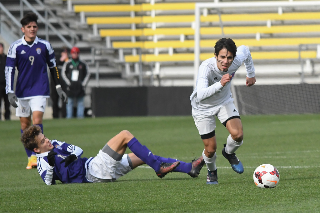 . Eric Bonzar�The Morning Journal<br> Bay midfielder Kevin Joyce (7) chases down the ball after taking it from Columbus St. Francis DeSales\' defensive forward Josh Conroy (16) in the D-II State Soccer Championship game, Nov. 11, 2017.
