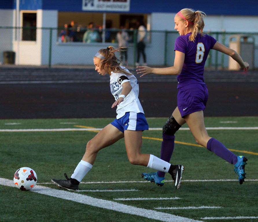 . Randy Meyers - The Morning Journal<br> Midview\'s Colleen Benton tries to control the ball near the corner as Avon\'s Rachael Hapanowicz defends from behind on Sept. 6.