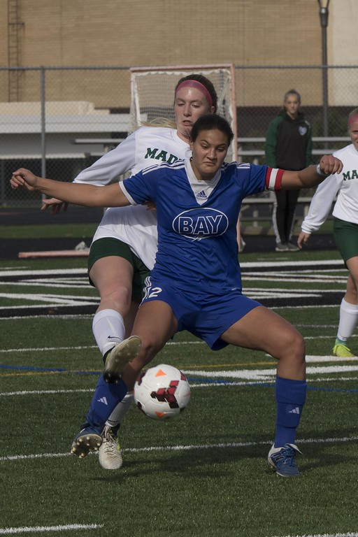 . Jen Forbus - The Morning Journal<br> Bay captain and midfielder Autumn Meisenburg works to hold off a Madison player on Nov. 4.