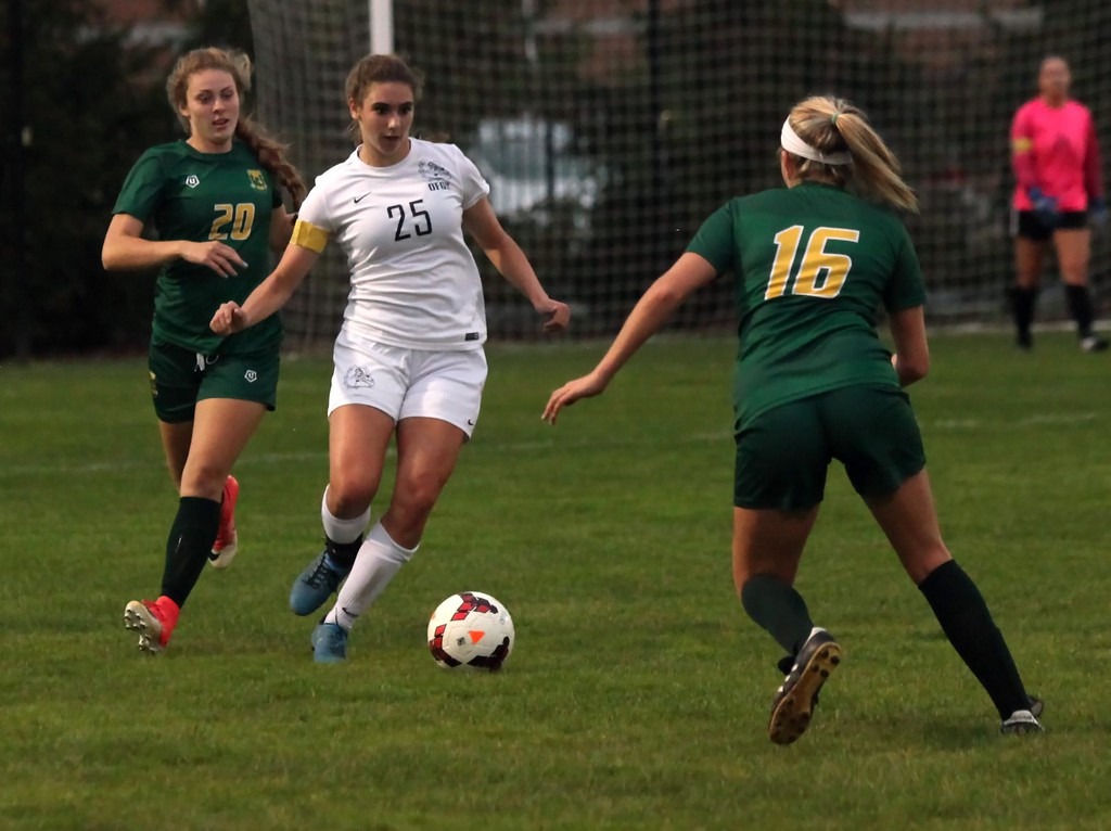 . Randy Meyers - The Morning Journal<br> Madeline Boka of Olmsted Falls moves the ball between Katie Turner and Helena Medve of Amherst on Nov. 13.