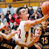 Don Knight | The Herald Bulletin<br /> Alexandria's Austin Paddock reaches for a rebound as the Tigers hosted the Liberty Christian Lions on Saturday.