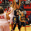 Barry Booher - The News-Herald<br /> Harvey's LaTresha Epps and Kirtland's Sydney Snyder go up for a rebound on Nov. 26 Harvey